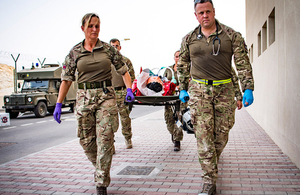 Members of the Joint Medical Group carry a simulated casualty on a stretcher