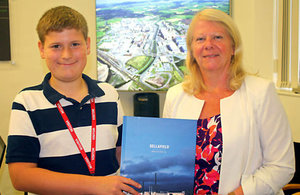 Samuel Boardman being presented with a Sellafield Ltd picture book by Dorothy Gradden