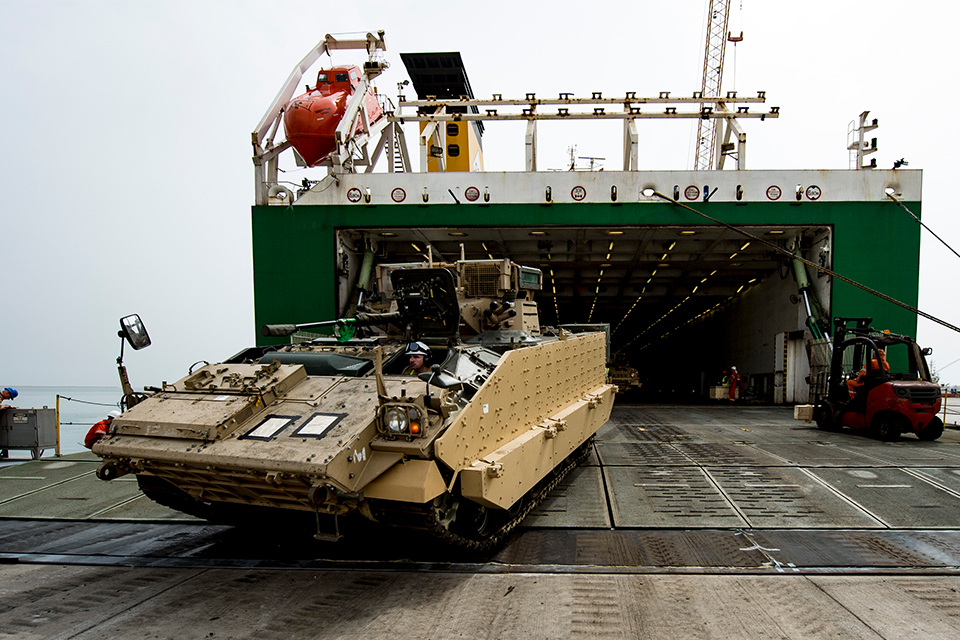 A Scimitar CVRT (combat vehicle reconnaissance tracked), used for reconnaissance, disembarks from the UK 'ro-ro' ship in Duqm.