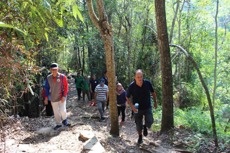 Minister Field with Yang Berhormat Dato Paduka Seri Haji Aminuddin trekking through Tasek Lama