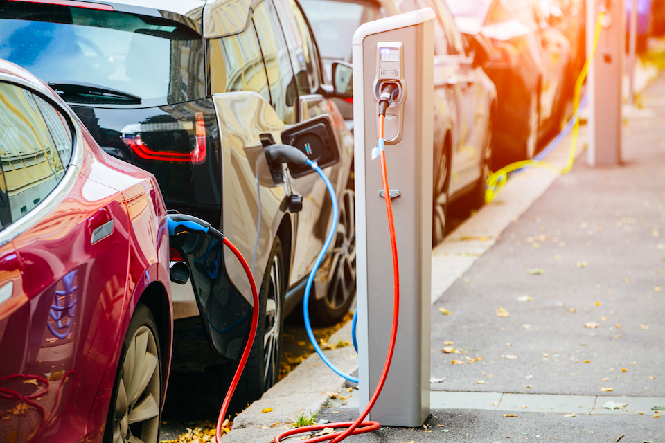 Electric vehicles charge in city centre.