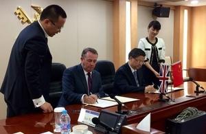 International Trade Secretary signing UK-China Dairy Agreement