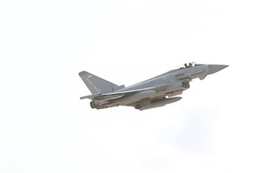 A Royal Air Force Typhoon takes off to interrupt a Russian maritime patrol aircraft's path towards NATO airspace.