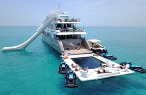 Picture of a superyacht with a selection of bespoke inflatables