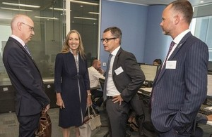 Photo, Baroness Fairhead meets Barclays executives at the launch of the new trade centre.