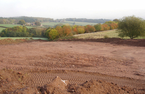Brown soil covering a field just outside of Exeter