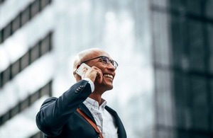Businessman on a mobile phone via Joseph Lund at Shutterstock