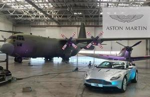 picture of Aston Martin Car in front of jets at Aston Martin