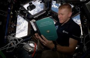 Tim Peake reading Principia on the International Space Station