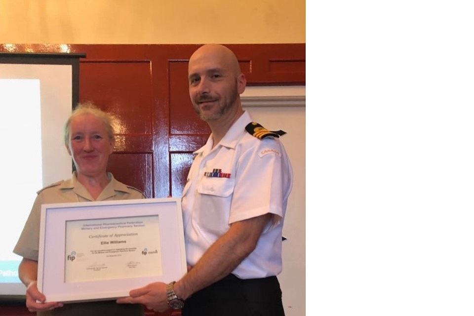 Lt Col Ellie William's receiving a Certificate of Appreciation from the Federation Internationale Pharmaceutique (FIP).