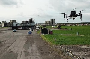 Drone performing trials over a test ground.
