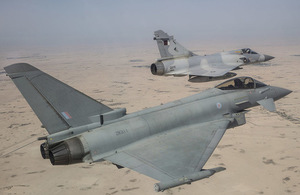 RAF Typhoon (foreground) and a QEAF Mirage jet taking part in a joint exercise held by the Emir of Qatar's Air Force. The exercise, operating from the Headquarters of Qatar's Fighter Wing at Al Udeid Air Base. Crown copyright.