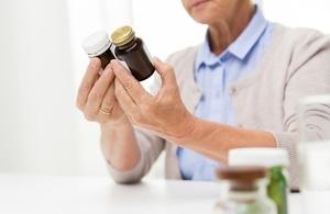 Lady looking at medicine