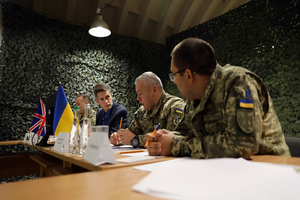 Defence Secretary Gavin Williamson sits around a table with his Ukrainian counterparts.