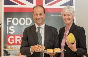 Minister Hollingbery holds a savoury pork moon cake with UK in Taiwan Representative Catherine Nettleton