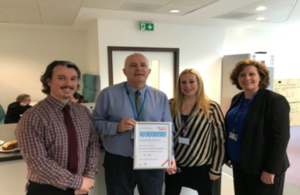 HMCTS Scotland staff holding certificate