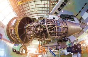 Airliner engine repairs in aircraft hangar