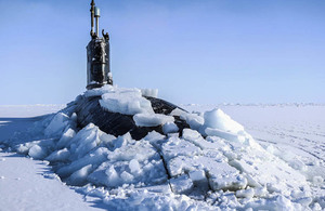 Royal Navy submarine HMS Trenchant breaks through the ice at the Arctic.