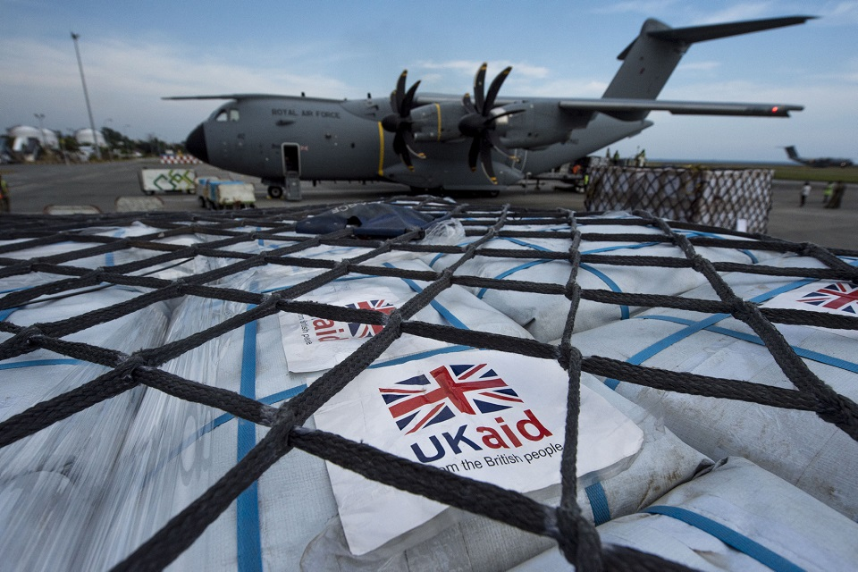 UK aid being unloaded at the international relief centre at Balikpapan.
