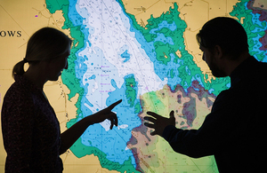 Two UKHO experts analyse marine geospatial data