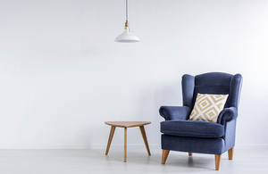 Blue armchair and wooden side table