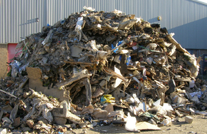 A pile of waste that has been dumped illegally outside a business