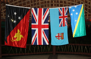 Flags of Papua New Guinea, United Kingdom, Fiji and Solomon Islands.