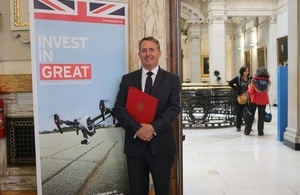 Picture of the International Trade Secretary at Downing Street in front of an Invest in GREAT campaign banner.