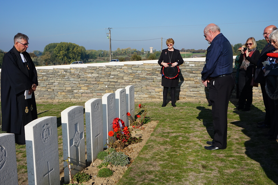 Tony Skilbeck lays a wreath on his grandfather's grave, crown copyright all rights reserved.