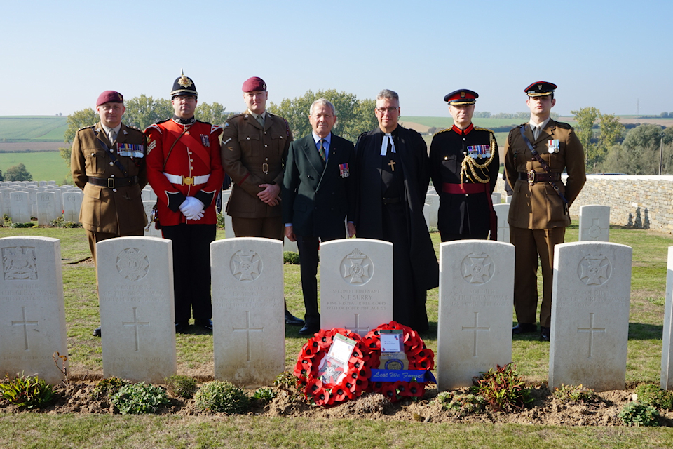 Members of the RAMC, The Mercian Regiment and The KRRC Association, at the graveside of Second Lieutenant Surry, crown copyright all rights reserved.