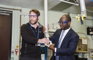 Science Minister Sam Gyimah trying out remote handling technology on the European JET fusion experiment at Culham