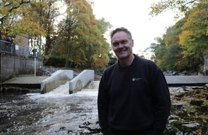 Image shows Paul Frear at the new fish pass in Stanhope.