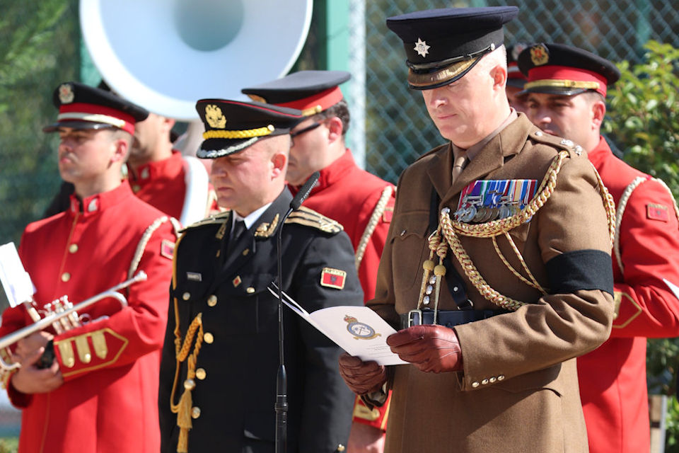 Lt Col Edward Melotte, MBE, Defence Attaché, conducts a reading during the service, Crown Copyright, all rights reserved