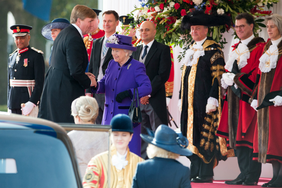 Her Majesty The Queen shaking hands with King Willem-Alexander on his arrival in Horseguards Parade
