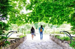 Two women walk through the botanical garden in Belfast via Dignity100 at Shutterstock