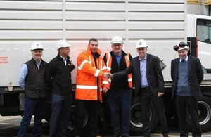 Magnox Managing Director Tony Moore shaking Adrian Owen, Wylfa Transport Manager's, hand.
