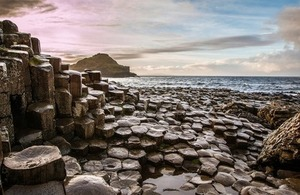Sunset at Giants Causeway via Pocholo Calapre at Shutterstock