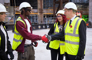 Picture of Jo Johnson with apprentices at Battersea Power Station.