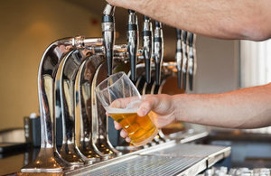 A pint of beer being poured.