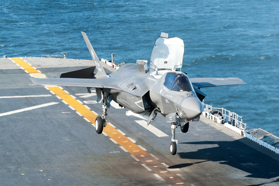 An F-35 Lightning II carries out a vertical landing on a US warship