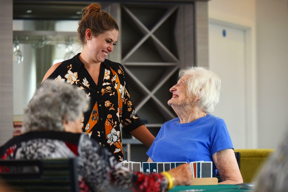One of ExtraCare's Wellbeing Advisors speaks with a resident