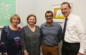 Sir Simon McDonald with Graeme Watkin's sisters and former partner