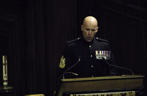 Warrant Officer Class 1, Glenn Haughton, reads during a service at The Royal Hospital Chelsea.
