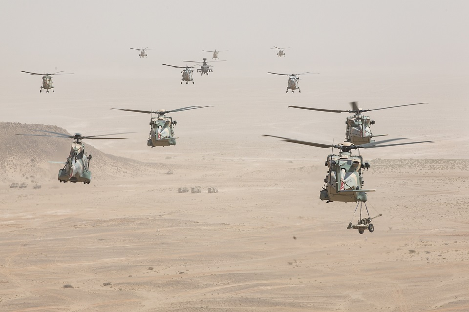 Royal Omani Air Force helicopters take part in the Exercise Saif Sareea 3 firepower demonstration. One is seen carrying a 105mm gun.