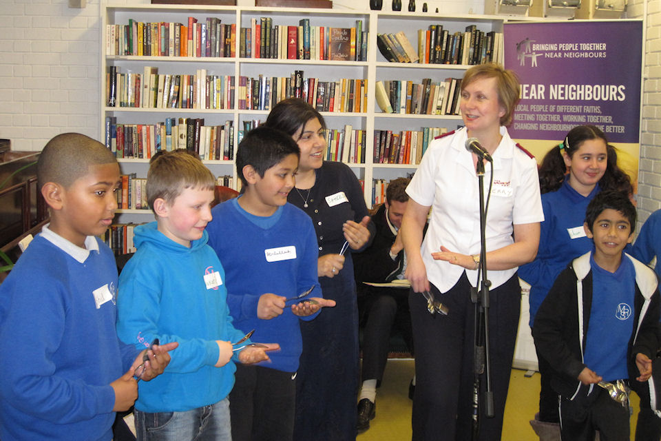 Baroness Warsi plays the spoons with children from the 'Baby Song' group