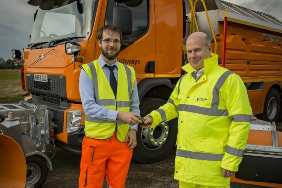 Romaquip technical director Stephen McKeown hands over the keys to Nick Harris, Highways England's executive director of operations