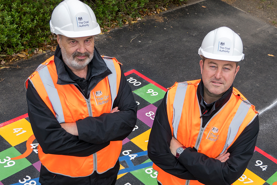 Two project managers from the Coal Authority at the reinstated playground