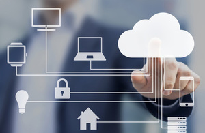 Businessman touching a cloud connected to many objects on a virtual screen, concept about internet of things