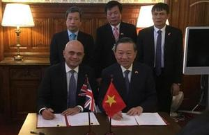 Home Secretary Sajid Javid with Senior Lieutenant General To Lam, the Vietnamese Minister for Public Security.