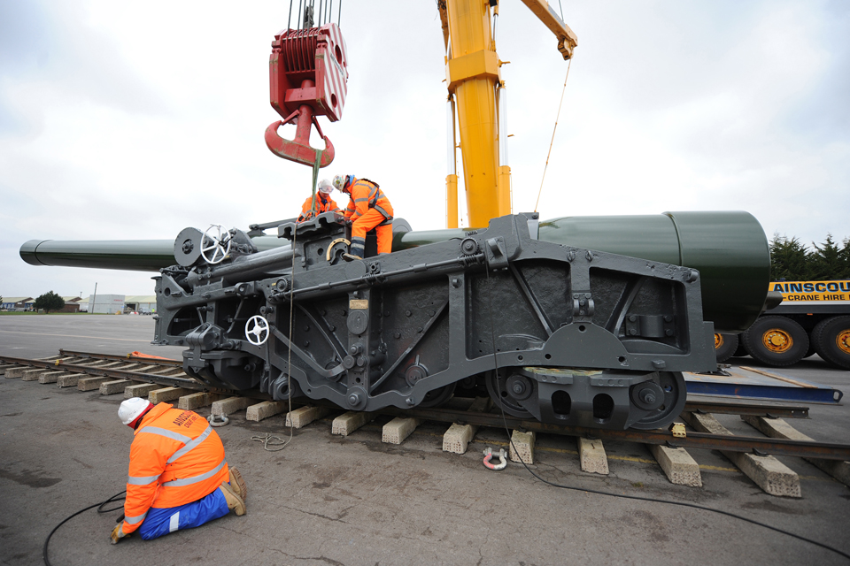 Specialists work to dismantle the gun for transport to the Netherlands